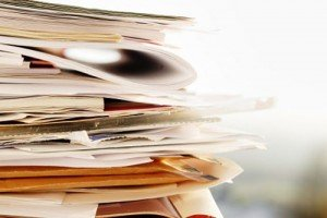 paperworks needs to be done- stack of papers, folders and envelops
