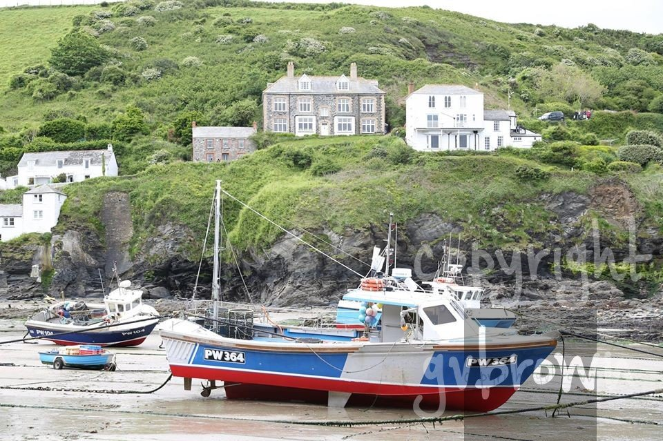 Boat in Port Isaac Harbor, low tide