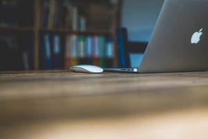 desk laptop and books by markus spiske